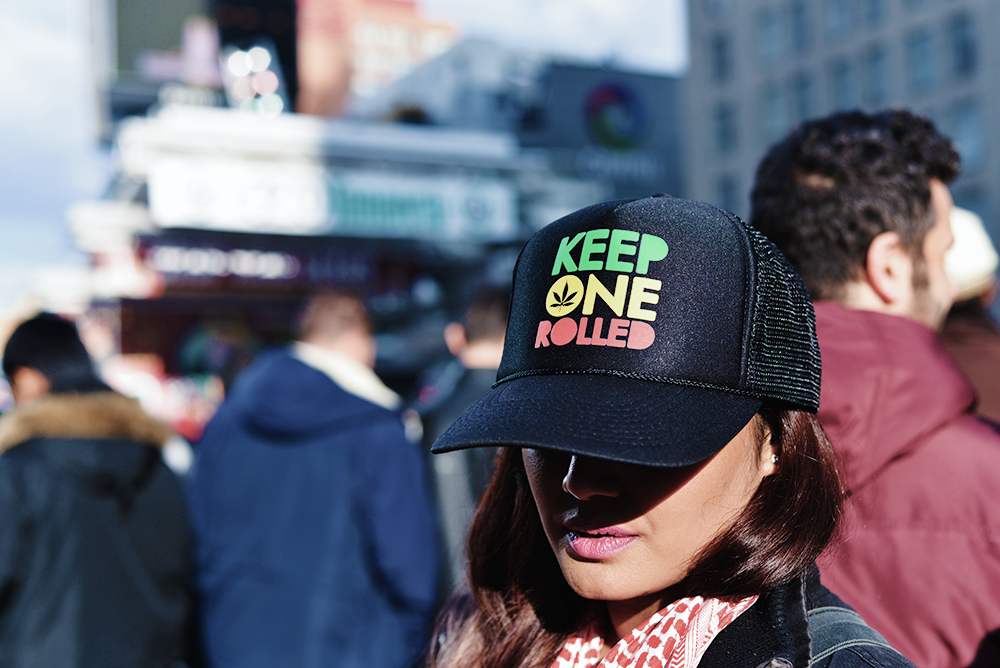 Capitol Compliance Management blog - Stay compliant for events, conventions, and demos. Photo features a woman wearing a hat that reads 'Keep One Rolled'.